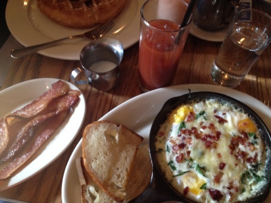 Lower east side breakfast: gruyere, egg and spinach skillet, perfect bloody mary, and bacon.